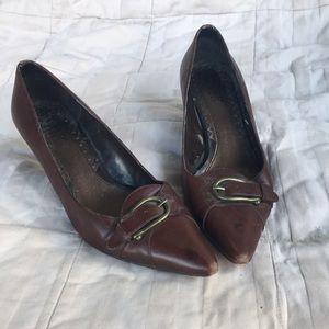 Chocolate heels, brass buckle.